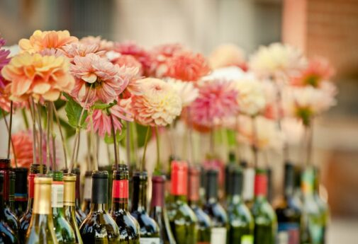 Zinnias in wines bottles, wedding at the Balch Hotel