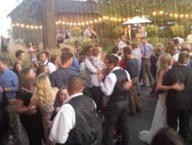 Wedding party dancing on the patio, Balch Hotel